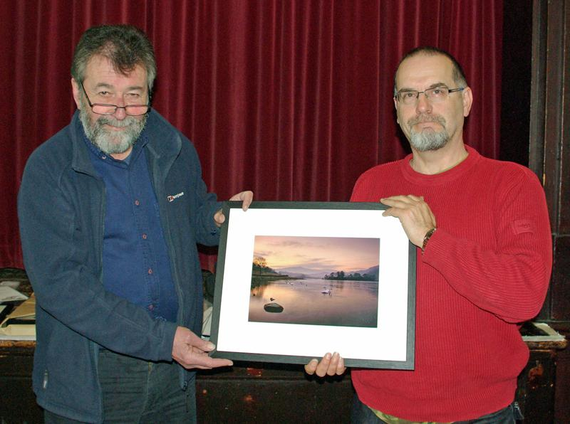 Eric Robson presents a framed photograph of his winning entry to Niels Rasmussen for winning the Themed Class of the 2014 Photographic Competition. - David Johnson