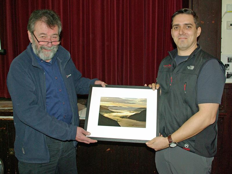 Eric Robson presents a framed photograph of his winning entry to Andrew Clayborough for winning the Open Class of the 2014 Photographic Competition. - David Johnson