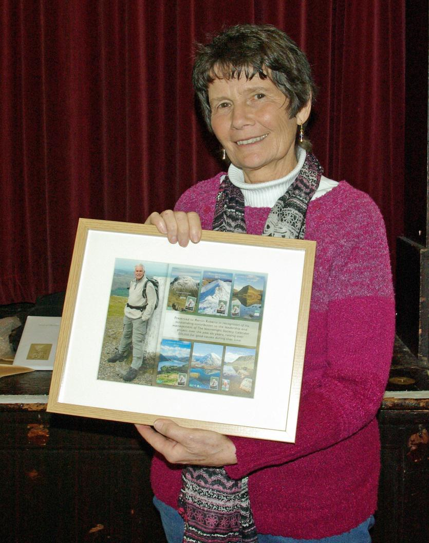 Jenny Whalley with the framed montage, which will be given to Martin Robaerts. - David Johnson